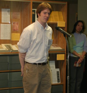 Dylan Yeats stands in front of a microphone