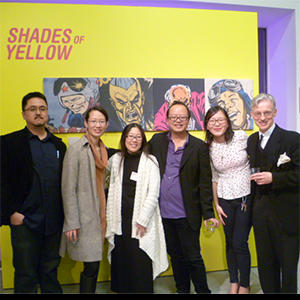 """D. Daniel Kim and guests in front of """"Shades of Yellow"""" wall"""