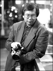 Corky Lee holding a camera
