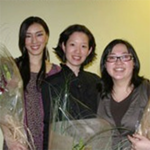 Emily Chu and curatorial staff of Art, Archives and Activism smile and hold bouquets of flowers