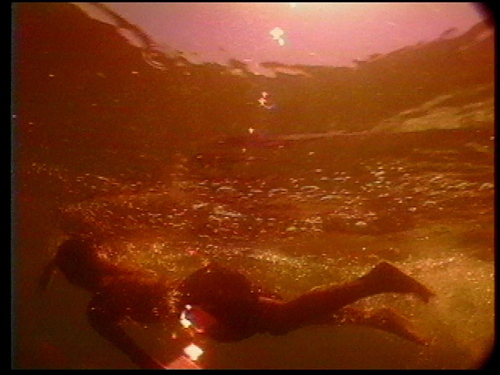 Person swimming in a red ocean