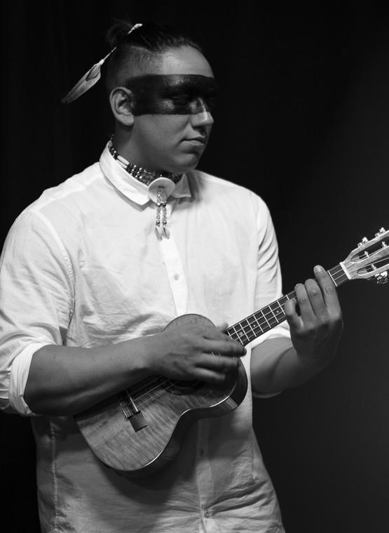 Black and white image of person playing the ukelele