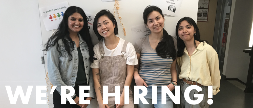 "Four APA Institute student staffers stand shoulder to shoulder, smiling at the camera. Text on image reads, ""We're Hiring!"""