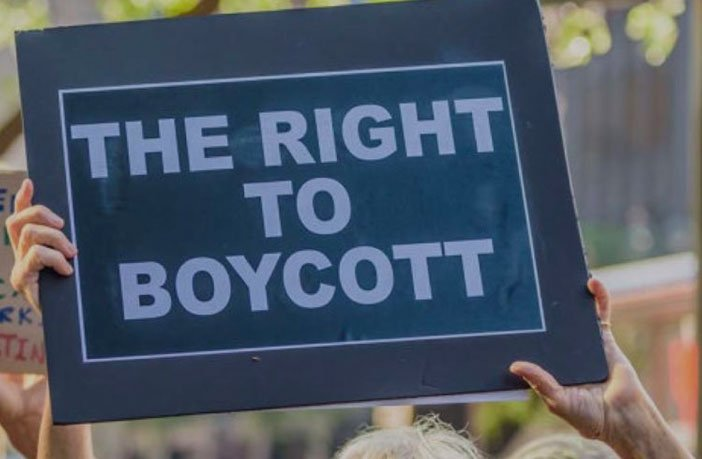"Black sign that reads, ""The Right to Boycott"""