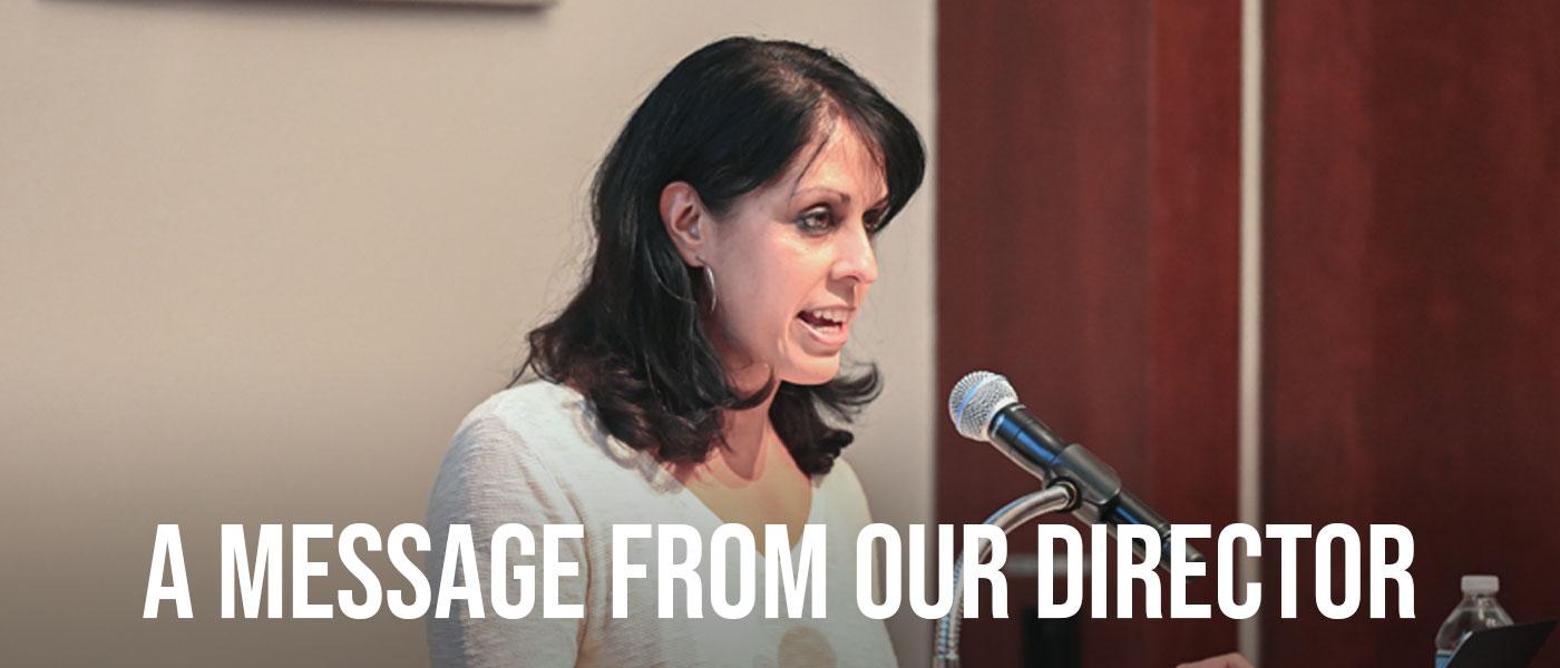 Crystal Parikh speaking at a podium