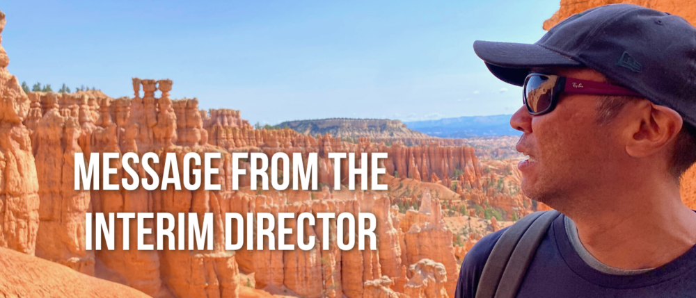 Image of Interim Director Dean Saranillio looking at a mountain range
